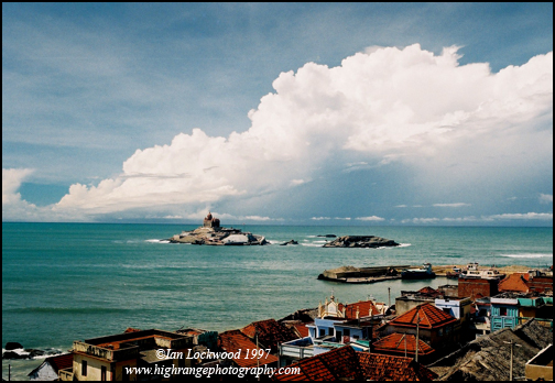 Monsoon clouds gathering over the Vivekananda memorial at Kanyakumari (before the Thiruvalluva statue was built (June 1997)