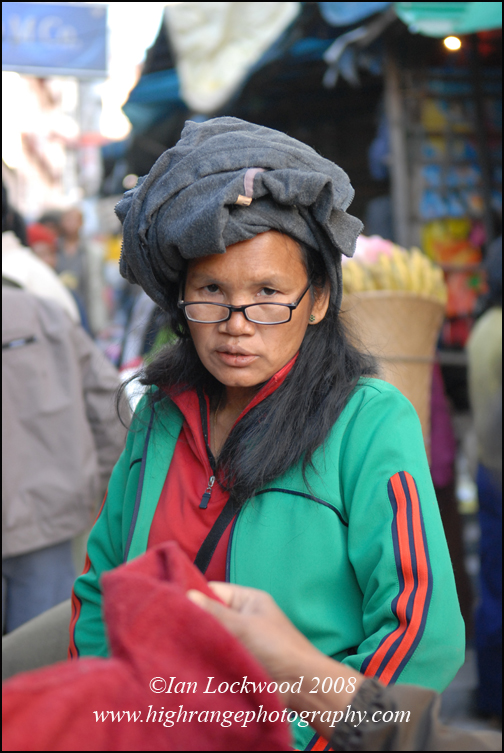 Woman selling used clothes in Aizawal's market