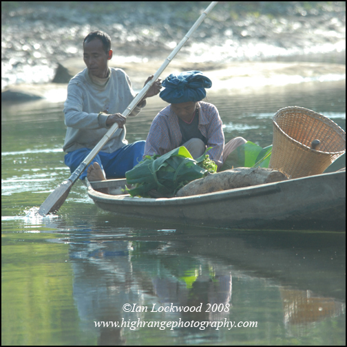 Boat with Mizo couple negotiating the Twlang River north of Aizawl