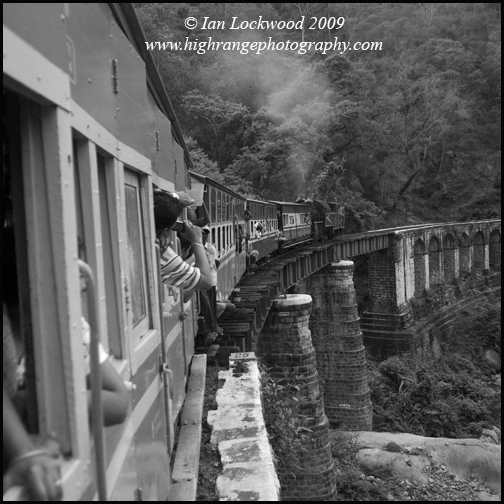One of numerous bridges on the ascent to Conoor, with the steam locomotive pushing the three passenger cars