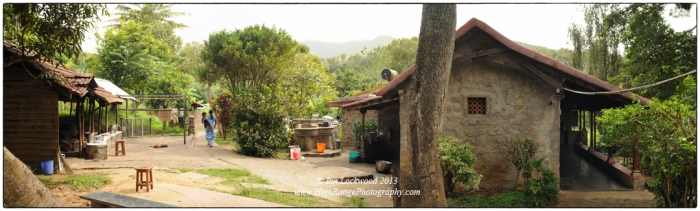 Kitchen area of the Sholai School oveshadowed by  the higher Palani Hills.