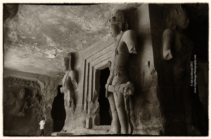 Dvarapalas (guard figures) at Elephanta with Siva (Andhakasura Vadh) in the back lett.