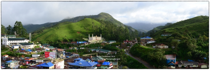 Panoramic view of Munnar during a break in the South West Monsoon. Note the church, mosque and temple in the image. The once sleepy tea-planting town is named for the three rivers that converge here.