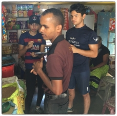 Conducting a survey in a Kudawa tea shop.