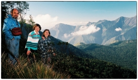 Merrick, Sara Ann and Anna looking down at Pampadum and Top Station from Vandaravu on an epic drive across the Palani Hills to Munnar. The road was completley blocked shortly after. (December 1997).