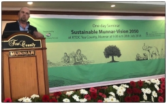 The author speaking about hill station sustainability in south India's mountains.