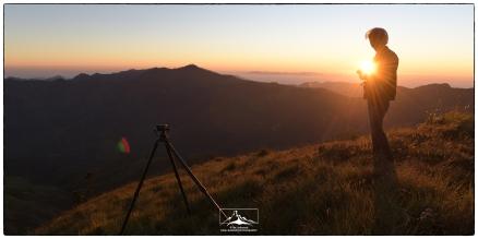 Danish on Cloud Land's Peak for sunrise. Perumal peak is on the center left of the image.