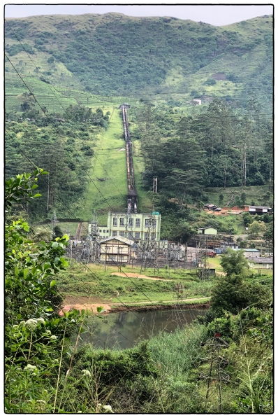 Wimalasurendra Hydroelectric Power Station showing the penstock and generating house. The powerhouse is fed though a 3 km tunnel by the Castlereigh reservoir. Note the remnants of montane forest above the surge tank. (December 2018)